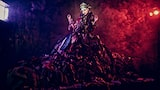 Frank-Doorhof-sony-alpha-7RII-model-wearing-flamboyant-dress-lit-by-purple-and-red-light
